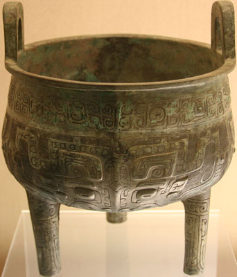 large, three-legged bronze caldron