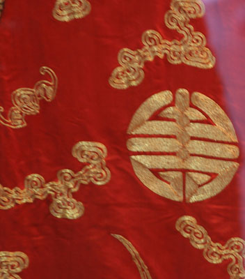 Ceremonial robe with gold coiled cloud embroidery