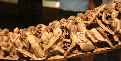 Ivory tusk with a carving of a crowd of people