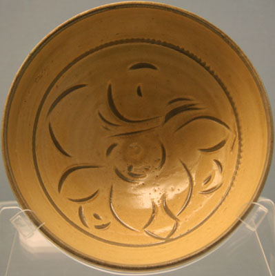 Ginger-yellow glazed porcelain bowl with lotus pattern