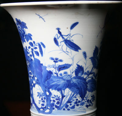 Blue and white porcelain flower container with a praying mantis design