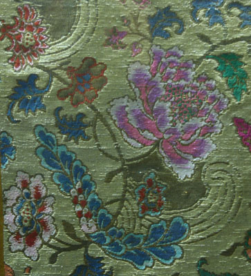 Satin with floral design on gold background
